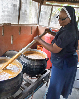 Janet Makinde SSL preparing food for the homeless people of Lagos, Nigeria